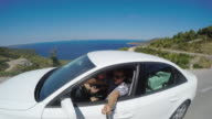 POV Tourist driving a car on coastal road