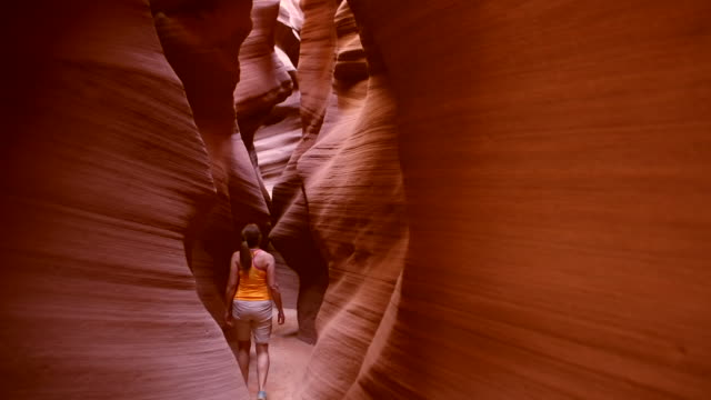 A tourist explores a slot canyon in Page, Arizona.