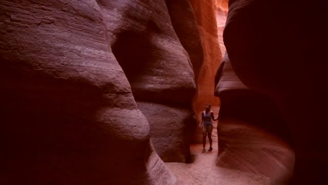 A tourist explores the Canyon X slot canyon in Page, Arizona.