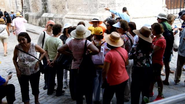 Tourist groups visiting Old Havana, a major tourist destination in Cuba
