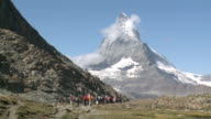 WS Tourist hiker roaming at riffelberg / Zermatt, Valais, Switzerland