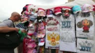 A tourist information sign stands in Red Square in Moscow Russia on Tuesday June 10 Painted matryoshka dolls sit for sale at a tourist stall A man...