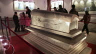 MS Tourist looking chinese ancient sarcophagus / tongchuan, shaanxi, china