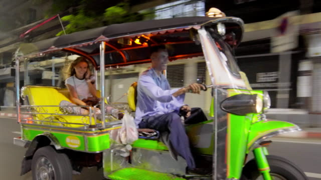 Tourist riding Tuk Tuk in Bangkok 4K