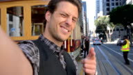 Tourist sending video selfie from San Francisco - POV