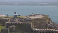 WS AERIAL POV ZO Tourist standing on Morro Castle / Old San Juan, Puerto Rico, United States