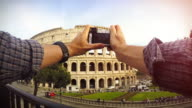 Tourist POV: taking a picture at the Coliseum, Rome