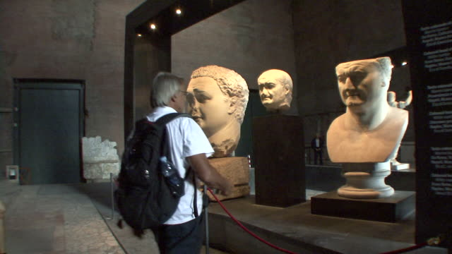 MS Tourist taking photo of Roman heads in Museum of Forum / Rome, Italy