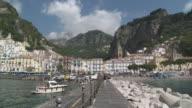 WS Tourist taking picture at Amalfi marina / Amalfi, Campania, Italy