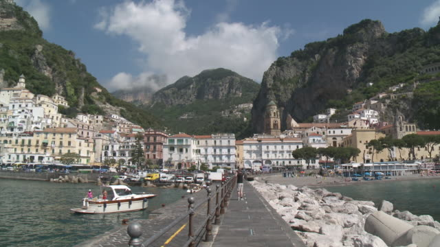 WS Tourist taking picture at Amalfi marina / Amalfi, Campania, Italy