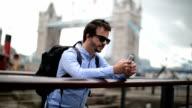 Tourist using mobile phone.