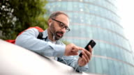 Tourist using smart phone