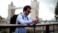 Tourist using smart phone.