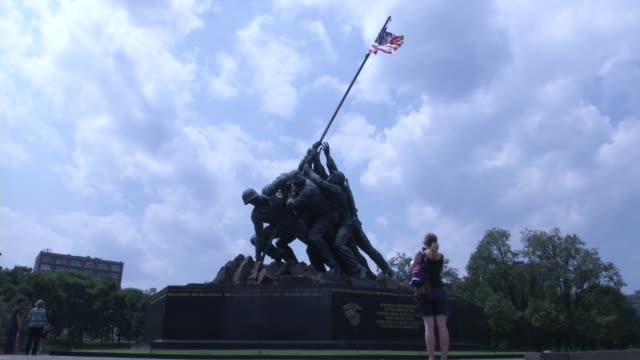 Tourist visit the United States Marine Corps War Memorial or It is a United States military monument located near Arlington National Cemetery in...