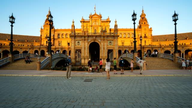 T/L Tourist walking at Plaza de Espana, Seville, Spain
