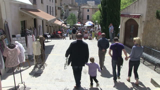 MS Tourist walking in old town  / Pollenca, Mallorco Baleric Island, Spain
