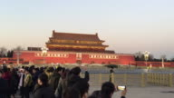 Tourist watch flag lowering ceremony at famous Tiananmen Square on Feb 13 2017 in Beijing China
