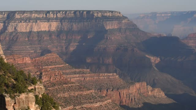 Tourists and hikers visit the Grand Canyon in Arizona on July 15 2015 Shots Beautiful wide landscape shots look down into the Grand Canyon Shots...
