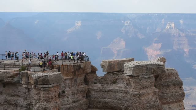 Tourists and hikers visit the Grand Canyon in Arizona on July 15 2015 Shots Wide shots of tourists observing the view of the Grand Canyon from an...