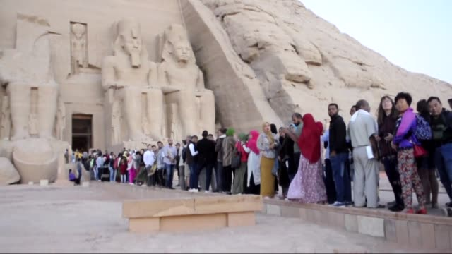 Tourists and local people gather at the temple of Abu Simbel to witness the sun illuminating the statue of King Ramses II on October 22 2017 in Aswan...