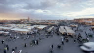 Tourists and locals peruse booths at the Djemaa el-Fna night market in Marrakesh, Morocco.