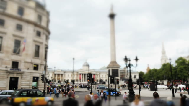Tourists and traffic in timelapse with Nelsons Column, Trafalgar Square, London