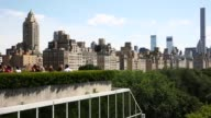 Tourists and visitors enjoy the view from the MET's roof on August 07 2015 in New York City