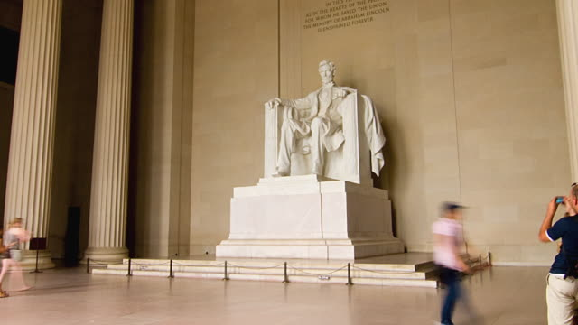 T/L WS Tourists at Abraham Lincoln statue in Lincoln Memorial, Washington D.C. USA