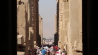 Tourists at Luxor Temple Shot from inside temple doorway Tilt down