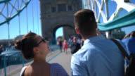 Tourists couple sightseeing and walking on the London Bridge