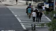 NYC Tourists crossing 10th ave &23rd Street