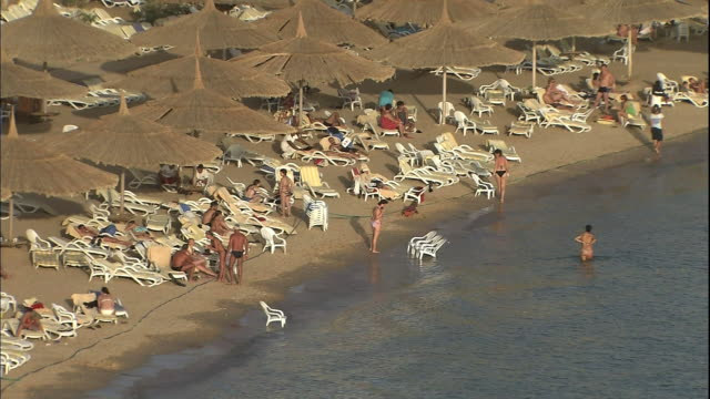 Tourists enjoy the beach of the Red Sea.