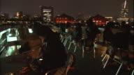 Tourists enjoy the lights of Yokohama, Japan from a cruise ship.