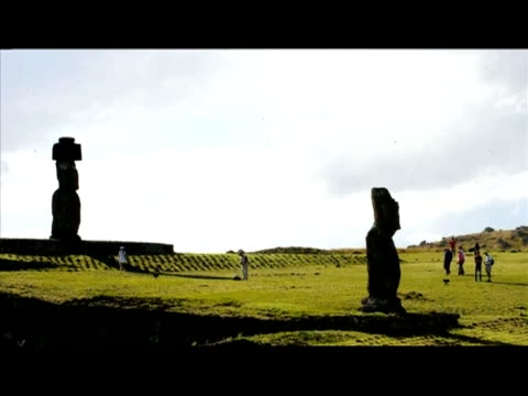 Tourists enjoy visiting the Moais stone statues of the Rapa Nui culture on Easter Island700 km off the Chilean coast in the Pacific Ocean on July 9...