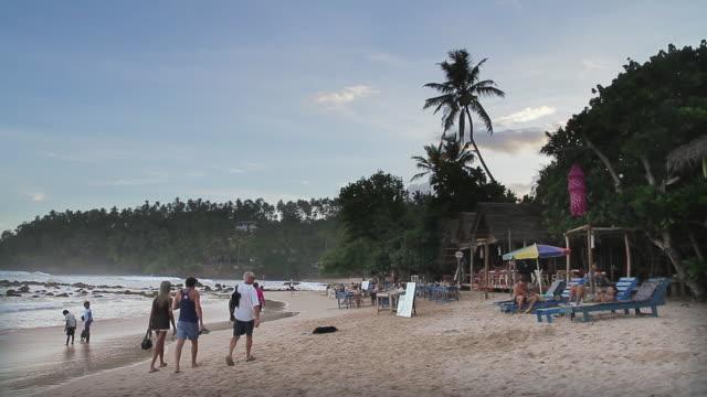 MS Tourists enjoying idyllic beach culture at Mirissa / Mirissa, Southern Province, Sri Lanka