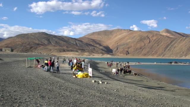 Tourists enjoying the breathtaking Himalayas landscapes around Pangong Lake, Ladakh, India