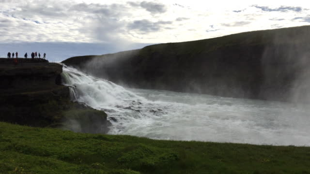 Tourists enjoying the Gullfoss waterfall in Iceland