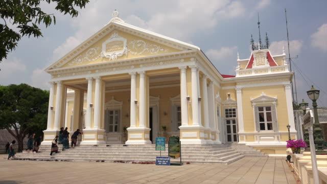 Tourists enter the royal residence at Bang Pa-In Royal Palace in Ayutthaya, Thailand