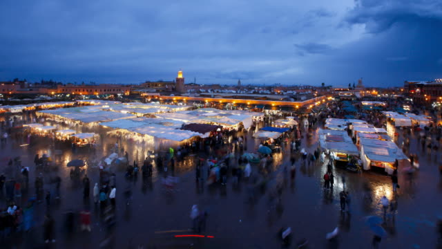 Tourists explore the Djemaa el-Fna night market in Morocco.