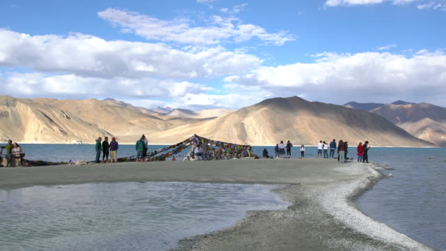 Tourists having a good time in front of the breathtaking Himalayas around Pangong Lake, Ladakh, India