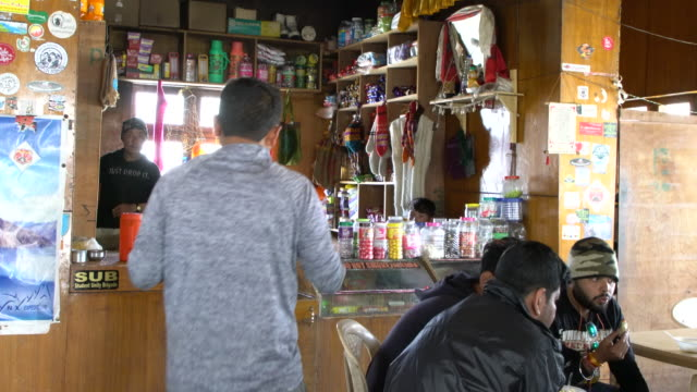 Tourists having a rest in the Cafe at The Chang La Pass, Ladakh, India
