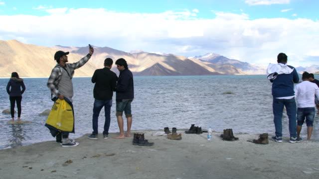 Tourists having fun and enjoying the good weather around Pangong Lake, Ladakh, India