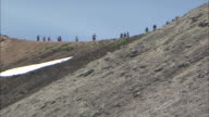 Tourists hike along a ridge on Mt. Norikura in Japan.