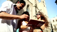 Tourists in Barcelona with guide book