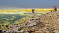 Tourists in the Danakil Depression on January 22 2017 in Dallol Ethiopia The depression lies 100 metres below sea level and is one of the hottest and...
