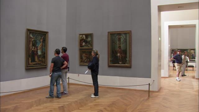 WS PAN Tourists looking at Durer's paintings in Alte Pinakothek, Munich, Bavaria, Germany