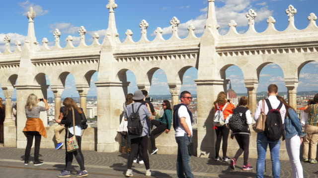 Tourists Looking At View In Budapest Fisherman's Bastion