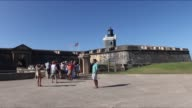 Tourists near Fort San Cristobal and Fort San Felipe del Morro in San Juan Puerto Rico on Monday Feb 10 Wide shot of tourists standing outside Fort...