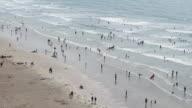 Tourists on Devon beach, England,UK