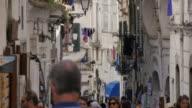 Tourists on narrow street near Duomo Piazza, Amalfi, Costiera Amalfitana (Amalfi Coast), UNESCO World Heritage Site, Campania, Italy, Europe